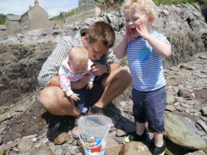 Dad and children rockpooling