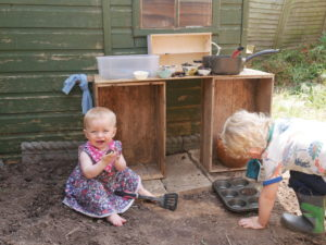 kids in mud kitchen